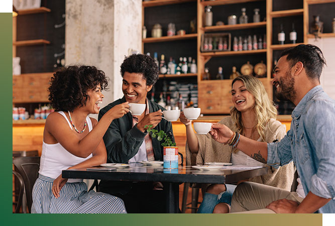 Group of friends having coffee and laughing