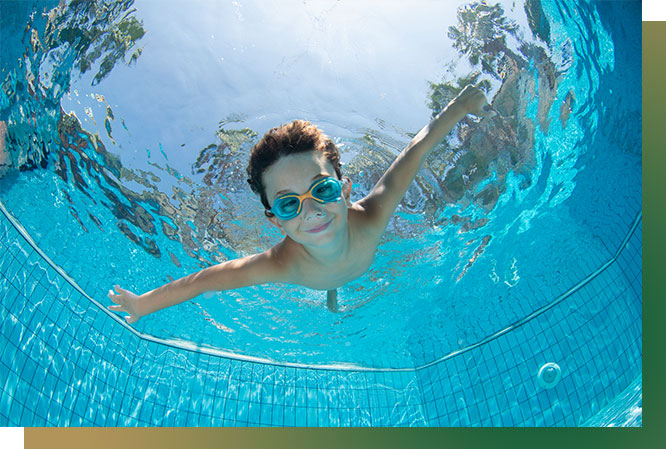 underwater image of smiling kid in pool